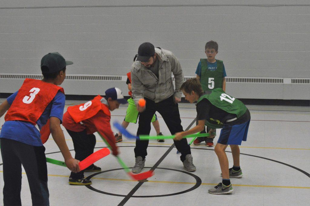 Kids playing ball hockey
