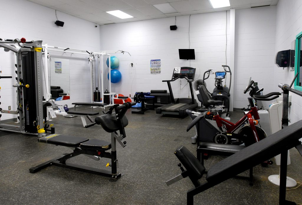 Room with multiple exercising equipment